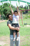 At the playground. A brother holding her young sister and playing Royalty Free Stock Photos