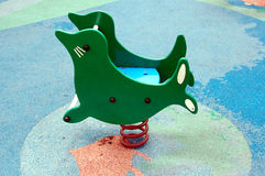 Playground 2. Rocking horse in a park Stock Images