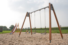 Playground. A children's playground with a slide, swing and a set with a spring stock photo