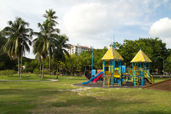 Playground. Big colorful children playground equipment in middle of park Royalty Free Stock Photo