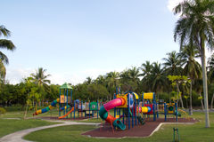 Playground. Big colorful children playground equipment in middle of park Royalty Free Stock Images