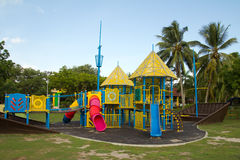 Playground. Big colorful children playground equipment in middle of park Royalty Free Stock Image