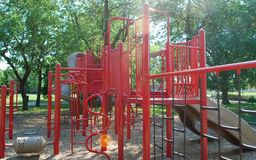 Playground. Children playground equipment and trees in a park Royalty Free Stock Image