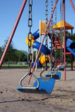 Playground. Colorful playground equipment with swings in foreground Stock Photos