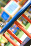 Playground. Swing close up in red and blue Stock Photography