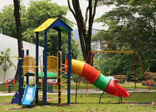 Playground. Children's playground, slide and seesaw royalty free stock image