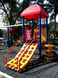 Playground. Modern playgrounds help children develop physical coordination, strength, and flexibility, as well as providing recreation and enjoyment Stock Images