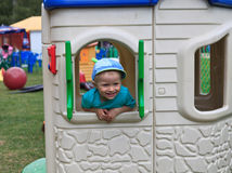 Playground baby. Baby playing in outdoor playground Stock Image