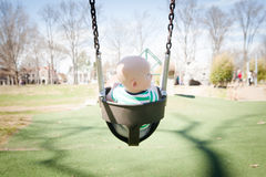 Playground: Baby in a Baby Swing Royalty Free Stock Photos