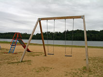 Playground on a bad day. Empty playground for children on a bank of the river on a day with bad weather royalty free stock images