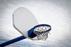 Playground Basketball Hoop and Backboard. A basketball hoop and backboard in an outdoor playground Royalty Free Stock Image