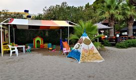 Playground on the beach in family hotel in Kemer, Mediterranean coast, Turkey stock images