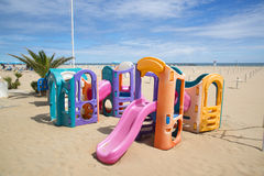 Playground on the beach in Rimini. Royalty Free Stock Photo