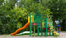Playground. A big colorful children playground equipment with a slide Royalty Free Stock Photography