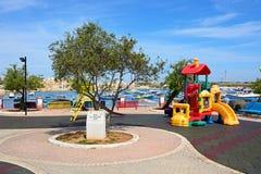 Playground by Birzebugga harbour, Malta. Royalty Free Stock Photo