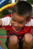 Playground boy 6. Young boy on playground royalty free stock photography