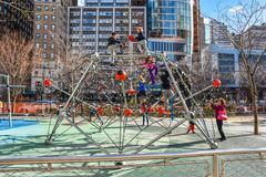 Playground with children along the Hudson River Greenway. Manhattan, New York, USA. Royalty Free Stock Image