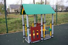 Playground of children`s near a house . Stock Photos