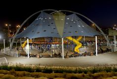 Playground in the children`s park. BEER SHEVA, ISRAEL - NOVEMBER 04, 2017: Tent above the playground with attractions in the children`s park stock photos
