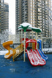 Playground. Children's slide is on the playground, which is in a  residential area of high-rise building stock photography