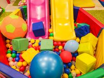 Playground, children`s slides, a play area of colorful plastic balls. Cheerful children`s leisure with balls in the play pool, o royalty free stock photos