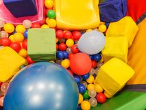 Playground, children`s slides, a play area of colorful plastic balls. Cheerful children`s leisure with balls in the play pool, o royalty free stock image