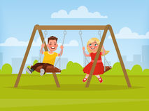 Playground. Children swinging on a swing. Royalty Free Stock Image