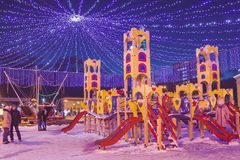 Playground for children in the town square in the new year royalty free stock photos