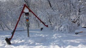 Playground covered in snow. Children's playground in the park covered by snow stock footage