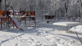 Playground covered in snow. Children's playground in the park covered by snow stock video