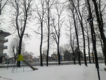 Playground covered in Snow. A Playground  covered in snow, with some trees and a slide Royalty Free Stock Photo