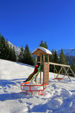 Playground covered in snow during the winter in Austria Royalty Free Stock Images