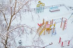 Playground covered with snow Stock Photos