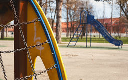 Playground. Details of a park playground, rainy day Royalty Free Stock Images