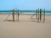 Playground on Empty Beach Stock Images