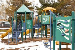 Playground is empty with the cold weather and snow on the ground Stock Image