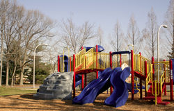 Playground Equipment. Color playground equipment at a park including a slide Stock Images