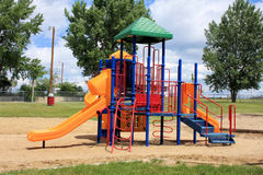 Playground Equipment. Children's colorful playground equipment in a city or rural park stock photo
