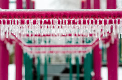 Playground equipment covered with ice after an ice storm. Icicles on playground equipment after an ice storm Stock Photography
