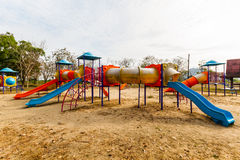 Playground equipment in the park. Big colorful children playground equipment in the park Royalty Free Stock Photography