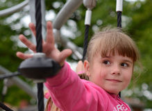 Playground exercises for a girl Stock Image