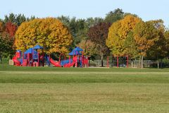 Playground in fall Stock Images