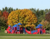 Playground in fall. Colorful playground equipment in a fall setting Stock Image