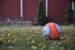 Playground with ball and fallen leaves. Playground in the fall with a left behind ball and leaves on the ground Stock Photography