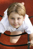 Playground fun. A child on playgym equipment ropes. (above view royalty free stock photography