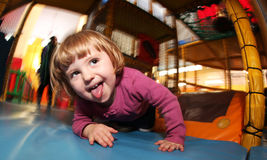 Playground fun. Little girl having fun on an indoor playground in an activity centre Royalty Free Stock Images