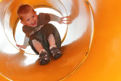 Playground fun. Fun on the slide Royalty Free Stock Photos