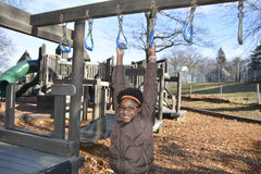 Playground Fun. Young black girl plays outside at recess Stock Image