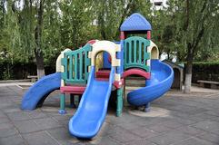 Playground in garden Royalty Free Stock Images