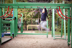 Playground and girl in motion on the ladder Stock Photo